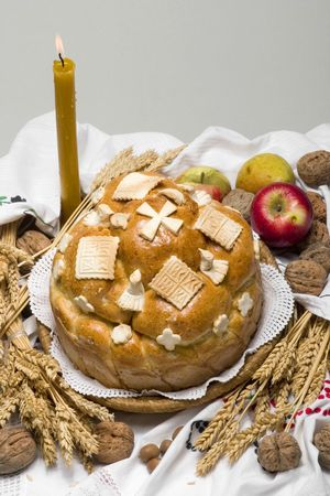 Orthodox Serbian religious cake with apple and candle photo