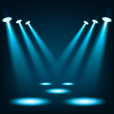 Blaue Scheinwerfer im dunklen Platz Hintergrund glänzen