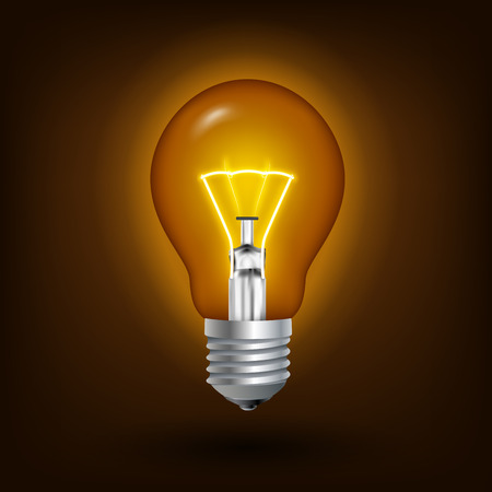 Incandescent energy saving light bulb illuminated