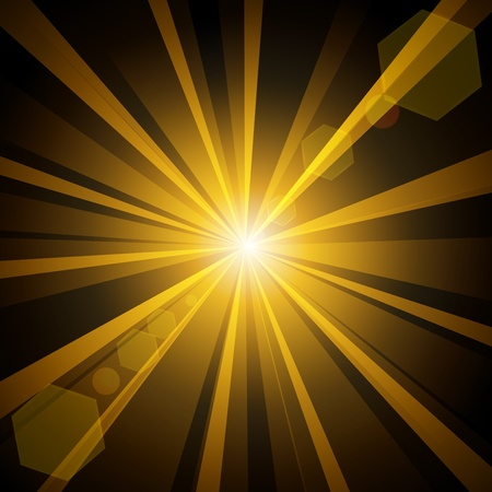 Golden shine with lens flare from darkness background