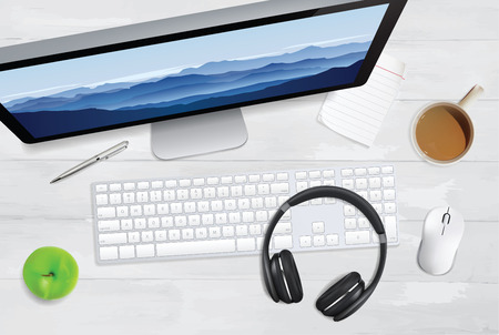 Top view of keyboard, digital screen, notepad and other accessories on white wooden table.