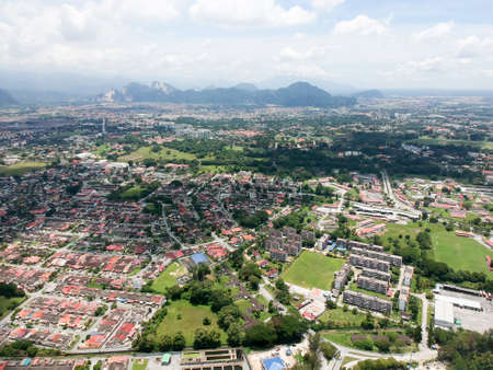 Aerial Photo - Birds eye view of the town of Ipoh, the capital city of the state of Perak, Malaysia and also the third largest city in the country.