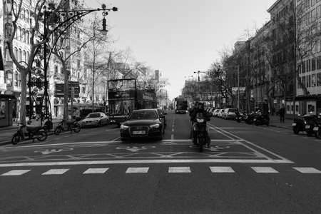 BARCELONA,SPAIN - February 26,2017: Shot of Pla?a de Catalunya street  in Barcelona, Spain. This image may contain noise ,blurry clouds due to long exposure, soft focus and poor lighting. Publikacyjne