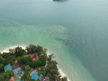 Aerial of Manukan Island of Sabah, Malaysia. Clear green ocean. Manukan Island is the most visited island in Sabah. The image contain soft focus, noise and grain. Stock Photo