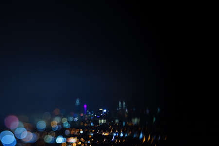Blurred dramatic night view of city with abstract of LED, neon lights and beautiful bokeh.