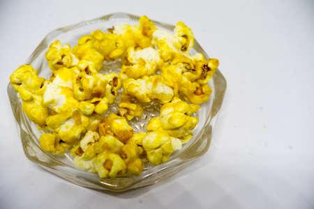 Sweet popcorn isolated on white background