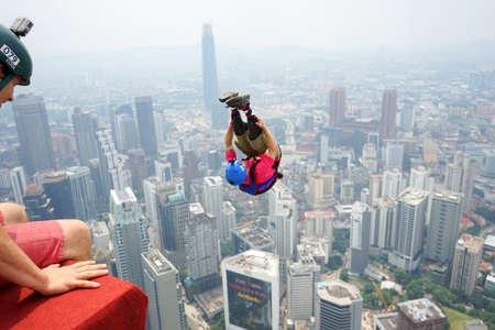 Kuala Lumpur, Malaysia – September 29, 2018: Base Jumpers jump from a 300m high deck during the Kuala Lumpur Tower International Jump. Editorial