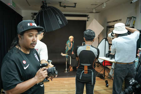 Kuala Lumpur, Malaysia – November 3, 2018: Group of photographers learning creative portrait during photo shooting in photography studio. Editorial