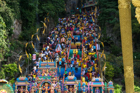 BATU CAVES, MALAYSIA - January 21, 2019: A celebration and devotee carrying kavadi preparing for ceremony prayers blessings during Thaipusam festival.