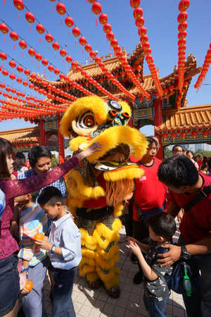 Kuala Lumpur, Malaysia - February 9, 2019: Beautiful Lion Dance during Chinese New Year celebration in Thean Hou Temple. Editorial