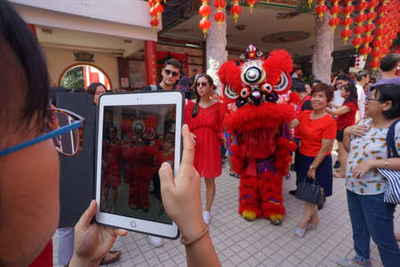 Kuala Lumpur, Malaysia - February 5, 2019: Beautiful Lion Dance during Chinese New Year celebration in Thean Hou Temple.