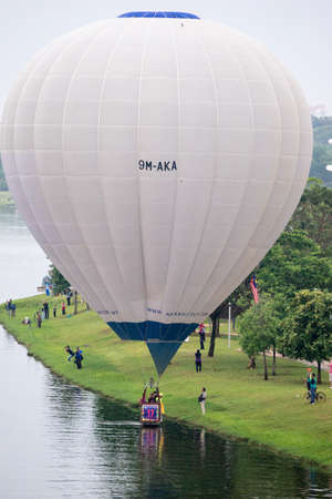 PUTRAJAYA, MALAYSIA - 31 MARCH 2019: The beautiful of multi shaped of hot air balloons floating over sunrise skies at the 10th Putrajaya International Hot Air Balloon Fiesta 2019. Editorial