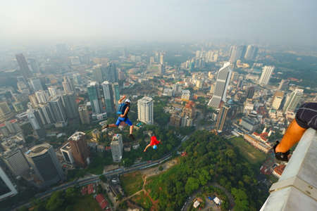 Kuala Lumpur, Malaysia – September 29, 2018: Base Jumpers landed from a 300m high deck during the Kuala Lumpur Tower International Jump.