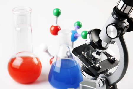 microscope lens: Microscope, 2 Flasks and Molecular Structure