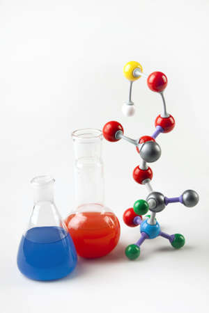 green chemistry: Atoms, and Flasks with colored liquid