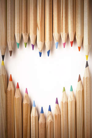 wooden pencil: Colored Pencils Heart Shape Stock Photo