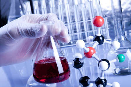 presentational: Atoms, Flask and Hands in gloves Stock Photo