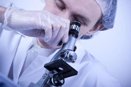 Scientist and Microscope photo