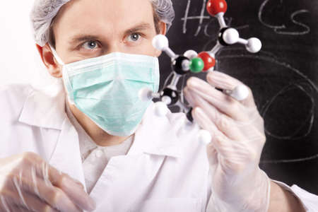 Scientist Looking at Atoms photo