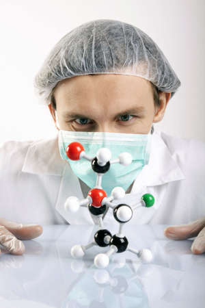 Scientist Looking over atoms photo