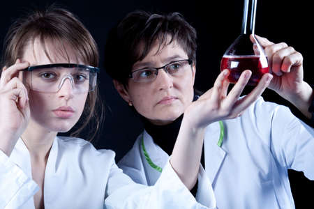 2 Scientist Experimenting photo