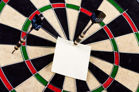 Yellow Sticky on Dartboard Stock Photo - 6563745