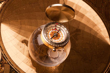 exploring: old map, compass and navigation equipment