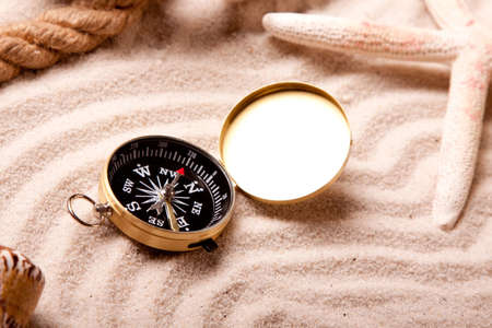 Compass and sand  photo