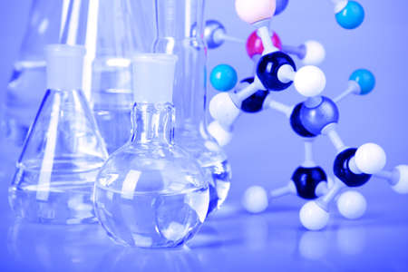 Flask and molecules Stock Photo
