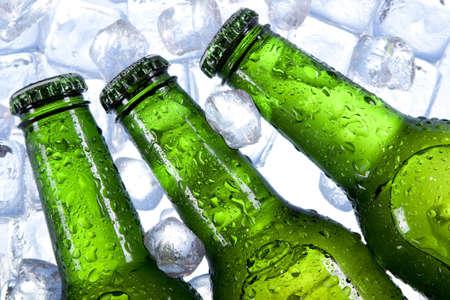 single beer bottle: beer in ice Stock Photo