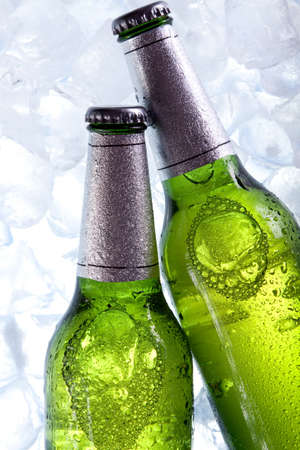 chilled: Beer in ice! Stock Photo