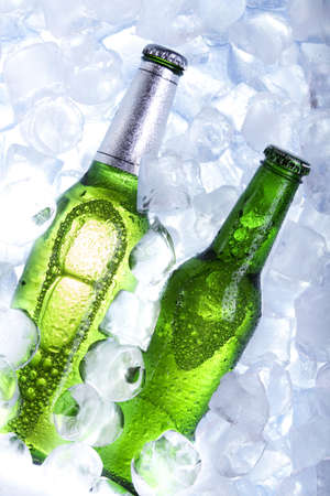 Chilled beer in ice photo
