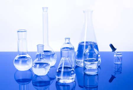 Laboratory glassware in blue background photo