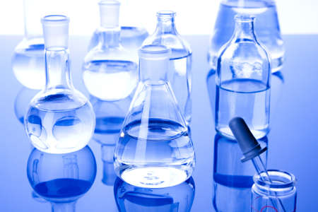 Laboratory glassware in blue background photo