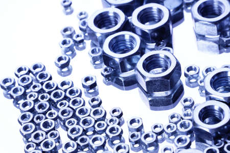 small group of objects: Steel Nuts on mirror Stock Photo