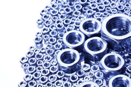 Steel Nuts on mirror Stock Photo - 8613173