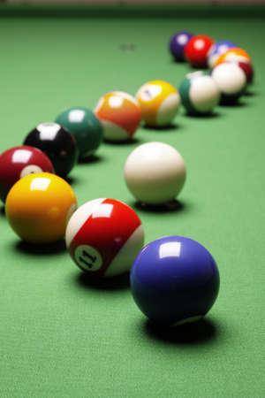 snooker table: Billiard balls on green table!