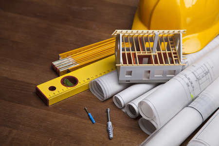 Construction plans with helmet and drawing tools on blueprints photo
