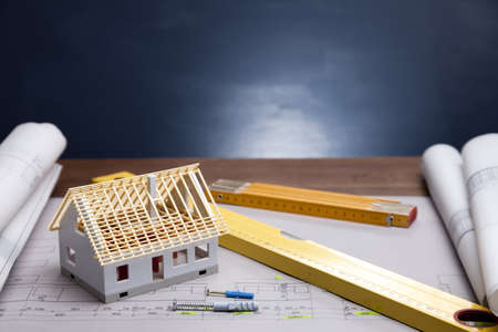 architect plans: Construction plans and blueprints on wooden table
