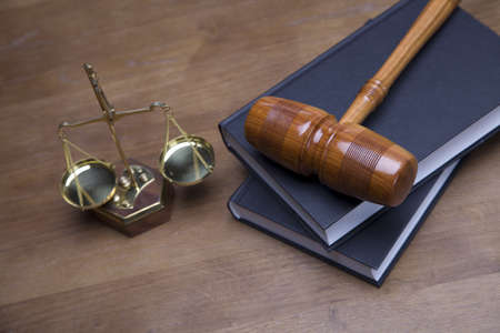 Gavel of justice and gavel on desk with dark background photo