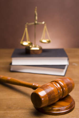 Scales of justice and gavel on desk with dark background Stock Photo - 11637741