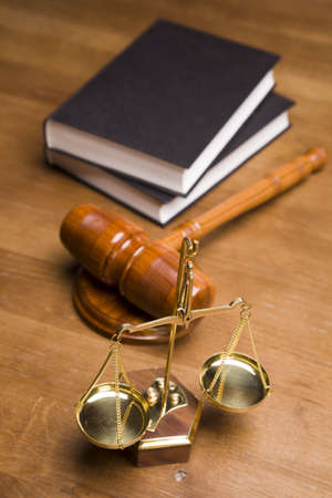 justice balance: Scales of justice and gavel on desk with dark background
