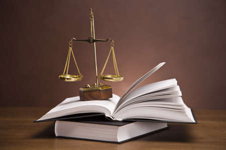 scales of justice: Scales of justice and gavel on desk with dark background