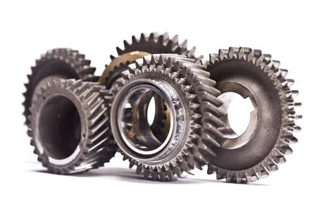 Gear wheels system over white background photo