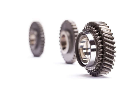 Gear wheels system over white background  Фото со стока