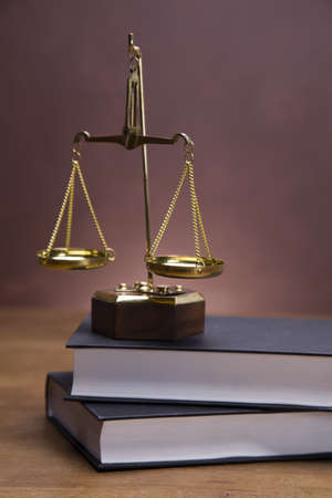 attorney scale: Scales of justice and gavel on desk with dark background