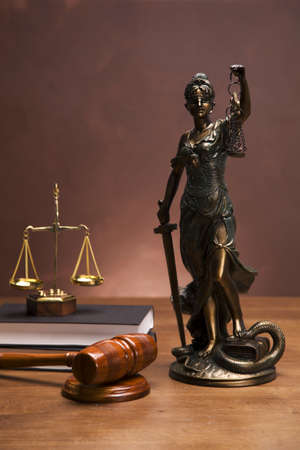 justice scales: Scales of justice and gavel on desk with dark background