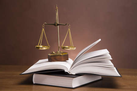 Scales of justice and gavel on desk with dark background Stock Photo - 11621095