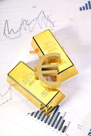 gold bars on graphs and statistics, studio shots, closeup Stock Photo - 13812803