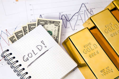 gold bars on graphs and statistics, studio shots, closeup photo